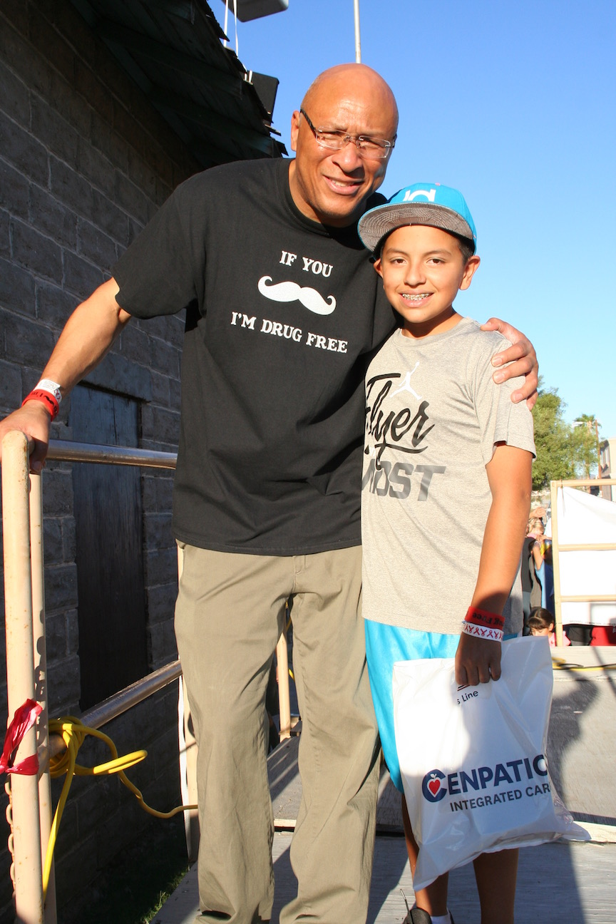 La Paz County Attorney and PAACE board member Tony Rogers helps out at Family Fun Day.